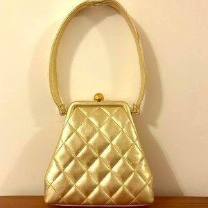 Authentic and  New Chanel gold quilted handbag